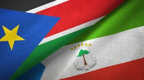 South Sudan and Equatorial Guinea two flags textile cloth, fabric texture. South Sudan and Equatorial Guinea two folded flags together royalty free stock images