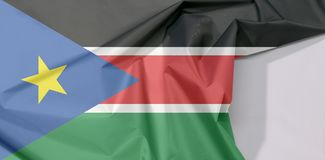 South Sudan fabric flag crepe and crease with white space. South Sudan fabric flag crepe and crease with white space, black red and green with white stripes royalty free stock images