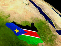 South Sudan with flag on Earth Stock Image