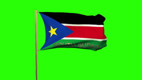 South Sudan flag with title waving in the wind. Looping sun rises style.  Animation loops stock video footage