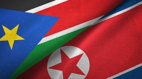 South Sudan and North Korea two flags textile cloth, fabric texture. South Sudan and North Korea two folded flags together royalty free stock image