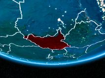South Sudan on planet Earth from space at night. South Sudan in red with visible country borders and city lights from space at night. 3D illustration. Elements Stock Photos