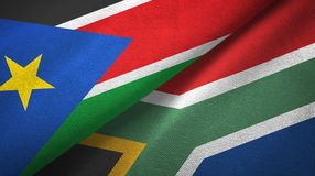 South Sudan and South Africa two flags textile cloth, fabric texture. South Sudan and South Africa flags together textile cloth, fabric texture royalty free stock images