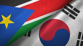 South Sudan and South Korea two flags textile cloth, fabric texture. South Sudan and South Korea flags together textile cloth, fabric texture stock images