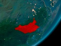 South Sudan from space at night. Night view of South Sudan highlighted in red on planet Earth with atmosphere. 3D illustration. Elements of this image furnished Stock Photo