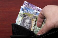Free South Sudanese Pounds In A Black Wallet Stock Photos - 216911603