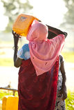 South sudanese woman drinking Royalty Free Stock Photo