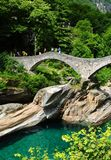 Old stone bridge over verzasca valley river in Ticino stock photo