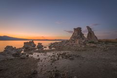 South Tufa Sunset. Unique rock formations known as Tufa meeting the waters edge of Mono Lake Stock Images