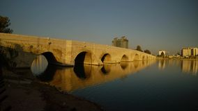 Old Rome Stone Bridge,built over 2000 years ago, the city of Adana summer sunny morning