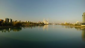 Turkish flag is lowered in mourning and Sabancı Merkez Mosque on the river in Adana. SOUTH TURKEY Adana city landscapes spring 2017 sunny day stock video footage