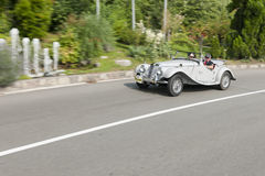 South Tyrol Rallye 2016_MG TD. Laterally offset frontal view of the MG TD with the number 27, built in 1952, 1251 CC displacement, 55 HP 4 cylinder, Schenna road Royalty Free Stock Photos