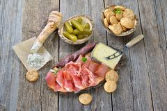 South tyrolean snack. With bacon, salami, red wine cheese, herb ham, fresh horseradish and local crunchy rye bread Royalty Free Stock Photography