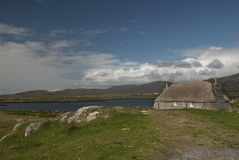 South Uist landscape with thatched cottage Royalty Free Stock Photography