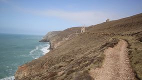 South West Coast Path Cornwall England UK. Cornwall coast tin mine England UK near St Agnes Beacon on the South West Path known as Wheal Coates stock video footage