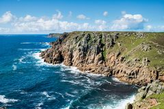 The South West Coast path in Cornwall. The south west coast path between Gwennap head and Land`s End on the Cornwall coast Stock Photos