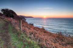 South West Coast Path at Lantivet Bay. The South West Coast Path as it leaves Pencarrow Head for Lantivet Bay between Polruan and Polperro on the south caost of Stock Photos