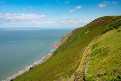 The South West Coast Path near Lynmouth. Coastline and ocean looking away from Lynmouth in North Devon, England Stock Photo