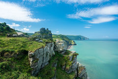 The South West Coast Path near Lynmouth. Hiker on the headland in Valley of the Rocks on South West coast path near Lynmouth Royalty Free Stock Images