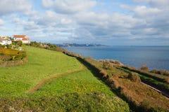 South west coast path near Torquay Devon above Saturn Cove Stock Photography