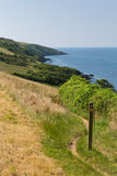 South West Coast Path Polkerris Cornwall. South West Coast Path from Polkerris Cornwall heading in a southerly direction on a beautiful summer day Stock Photo