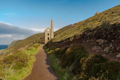 South west coast path and Towanroath shaft Engine House. Royalty Free Stock Photo