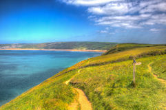 South west coast path towards Woolacombe Devon England UK in summer with blue sky in hdr Royalty Free Stock Images