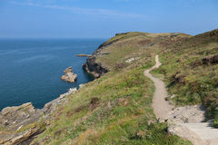 South West Coast Path. A view from the South West Coast Path on a sunny afternoon near Tintagel in Cornwall, England Royalty Free Stock Photos