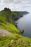 The South-West coastal path near Lynton. The Devon coastline in the Valley of Rocks Lynton.  The Valley of Rocks near Lynton, Devon s an ancient historic tourist Stock Photography