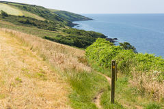 South West Coastal Path Polkerris Cornwall. South West Coast Path from Polkerris Cornwall heading in a southerly direction on a beautiful summer day Stock Images