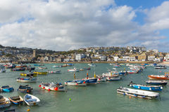 South west uk coast town St Ives Cornwall with boats in harbour. St Ives Cornwall uk boats in harbour in this beautiful tourist town in the summer sunshine Royalty Free Stock Images
