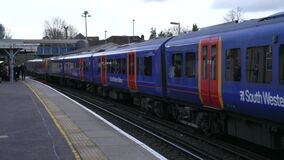 South Western Railway Train is Arriving to the Farnham Station in England
