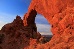 South Window Arch glowing at sunrise, Arches National Park, Utah, USA Royalty Free Stock Photo