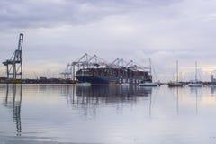 Southampton docks , Hampshire, UK. Southampton docks with yachts and container ship Stock Photo