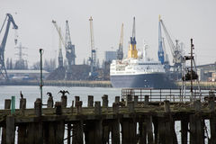 Southampton old pier and docks. The derelict old pier at Southampton docks with cruise ship, dockside and cranes behind stock images