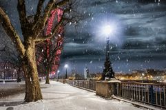 The Southbank in London, UK, with falling snow in winter. During night time Stock Images