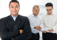 Southeast Asian business men. In office Royalty Free Stock Photo