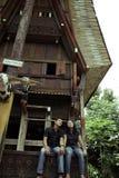 Southeast asian couple outdoor. At front of traditional tana toraja house Stock Photos