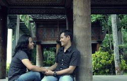 Southeast asian couple outdoor. At front of traditional tana toraja house Royalty Free Stock Image