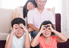Southeast Asian family at home stock images