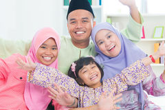 Southeast Asian family quality time at home. Muslim family living lifestyle Stock Image