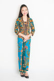 Southeast Asian female in batik dress Royalty Free Stock Photography