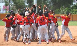 Southeast Asian Games in Palembang. Indonesian baseball team celebrating, after they defeat defending champion, Filiines at 26th Southeast Asian Games in stock photos