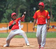 Southeast Asian Games in Palembang. Indonesian baseball team celebrating, after they defeat defending champion, Filiines at 26th Southeast Asian Games in stock image