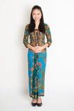 Southeast Asian girl in batik dress Stock Image