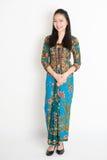 Southeast Asian girl in batik dress smiling Royalty Free Stock Photo