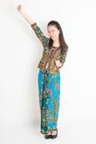 Southeast Asian girl celebrating success Stock Photo