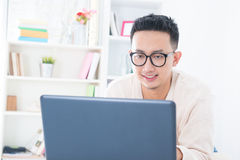 Southeast Asian male online Stock Photo