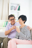Southeast Asian mature couple drinking Stock Photo