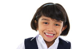 Southeast Asian primary school student. Head shot portrait of Southeast Asian primary school student over white background Stock Photo